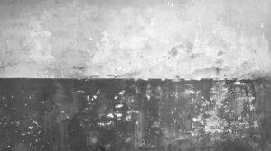 flaking-plaster-wall-grey